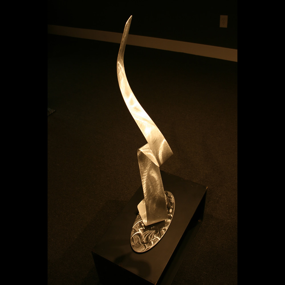 A LADY'S SILHOUETTE - Silver Metal Sculpture by Nicholas Yust